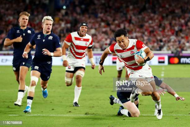 Keita Inagaki of Japan evades Stuart Hogg of Scotland to score their third try during the Rugby World Cup 2019 Group A game between Japan and...