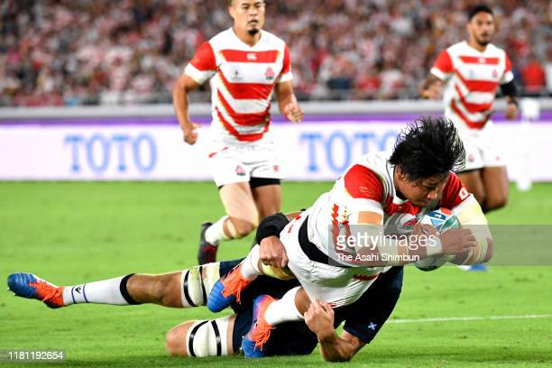 Keita Inagaki of Japan grounds the ball to score his side's second try during the Rugby World Cup 2019 Group A game between Japan and Scotland at...