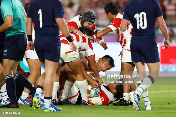 Keita Inagaki of Japan is congratulated by team mates as he touches down to score their second try during the Rugby World Cup 2019 Group A game...