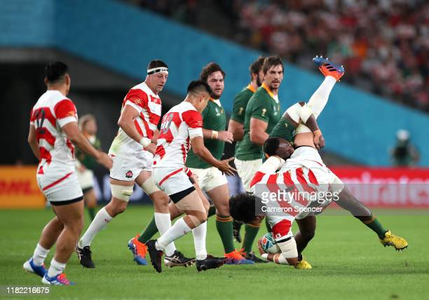 Keita Inagaki of Japan is spear tackled by Tendai Mtawarira of South Africa who is later given a yellow card during the Rugby World Cup 2019 Quarter...