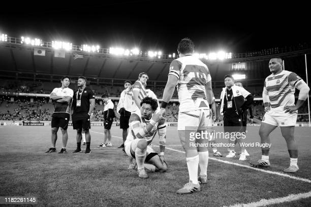 Keita Inagaki of Japan reacts on the pitch following defeat during the Rugby World Cup 2019 Quarter Final match between Japan and South Africa at the...