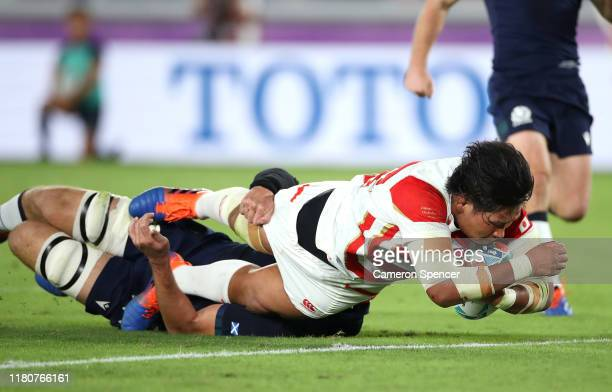 Keita Inagaki of Japan touches down to score their second try as he challenged by Grant Gilchrist of Scotland during the Rugby World Cup 2019 Group A...