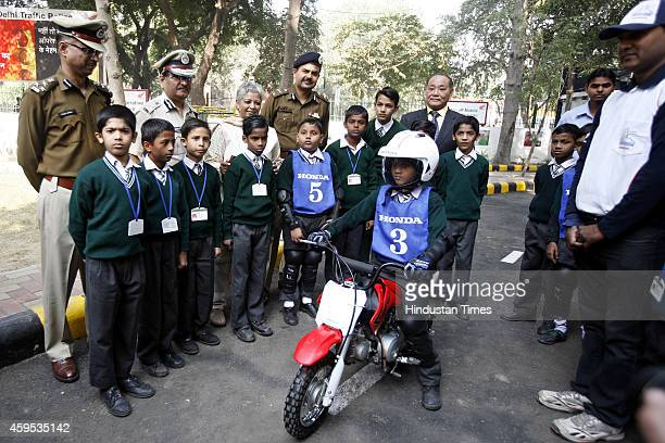 Keita Muramatsu President and CEO Honda Motorcycle and Scooter India with vimla Mehra Special Commissioner at newlyrenovated Traffic Training Park at...
