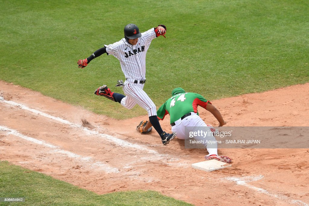 Keita Nakagawa #6 of Japan is tagged out by Alejandro Pineda #44 of Mexico at first base in the seventh inning during the Baseball Group B match between Japan and Mexico during the Universiade Taipei at the Xinzhuang Baseball Stadium on August 22, 2017 in Taipei, Taiwan.