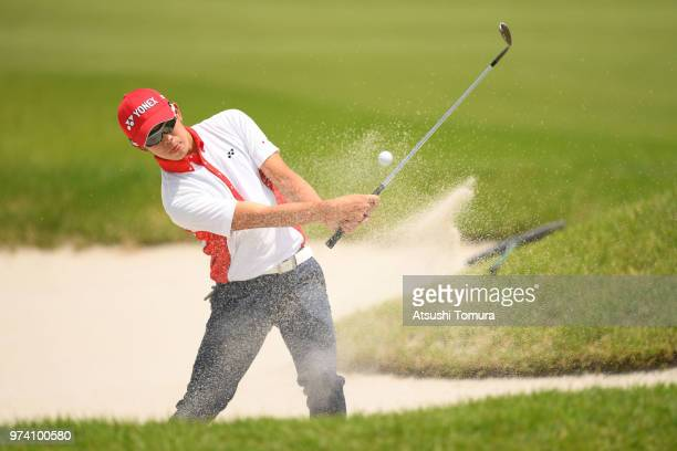 Keita Nakajima of Japan hits from a bunker on the 10th hole during the third round of the Toyota Junior Golf World Cup at Chukyo Golf Club on June 14...