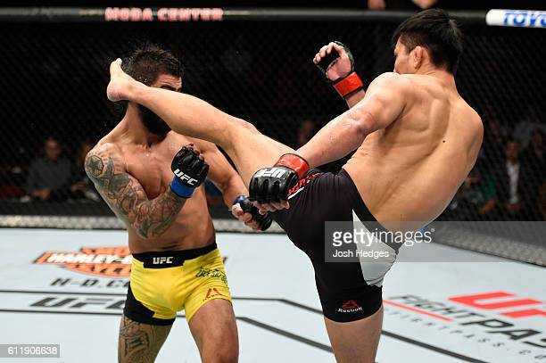 Keita Nakamura of Japan kicks Elizeu Zaleski dos Santos in their welterweight bout during the UFC Fight Night event at the Moda Center on October 1...