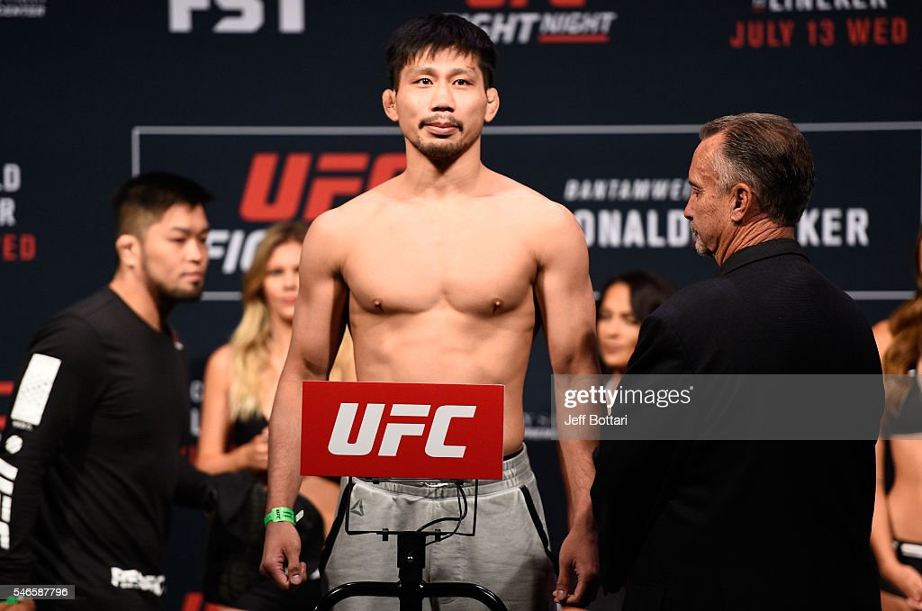 Keita Nakamura steps onto the scale during the UFC Fight Night weigh-in at Denny Sanford Premier Center on July 12, 2016 in Sioux Falls, South Dakota.