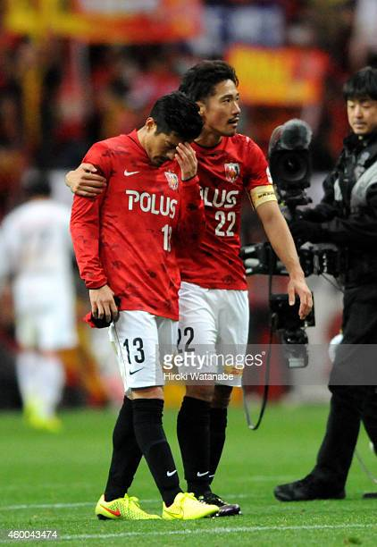 Keita Suzuki of Urawa Red Diamonds is consoled by Yuki Abe after the 12 defeat in the JLeague match between Urawa Red Diamonds and Nagoya Grampus at...