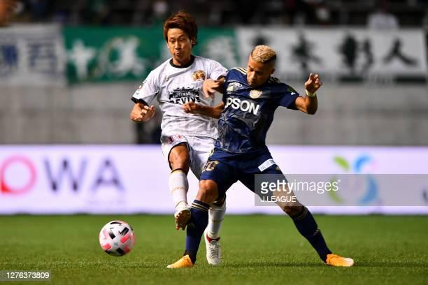 Keita TANAKA of FC Ryukyu and SERGINHO of Matsumoto Yamaga battle for the ball during the J.League Meiji Yasuda J2 match between Matsumoto Yamaga and...