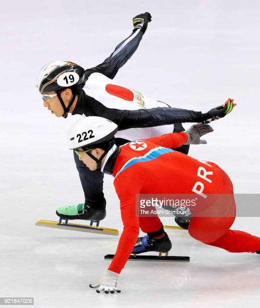 Keita Watanabe of Japan and Jong Kwang Bom of North Korea compete during the Short Track Speed Skating Men's 500m Heats on day eleven of the...