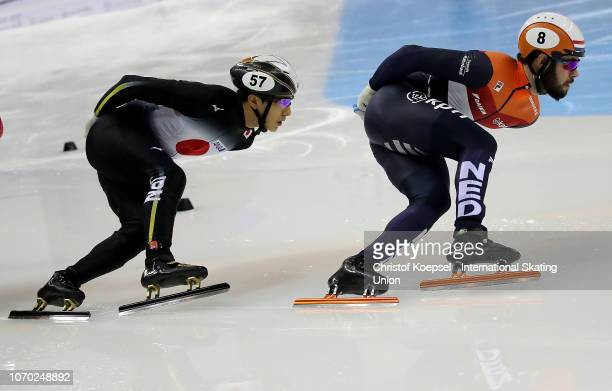 Keita Watanabe of Japan and Sjinkie Knegt of Netherlands compete during the men 1000 meter second semi final during the ISU Short Track World Cup Day...