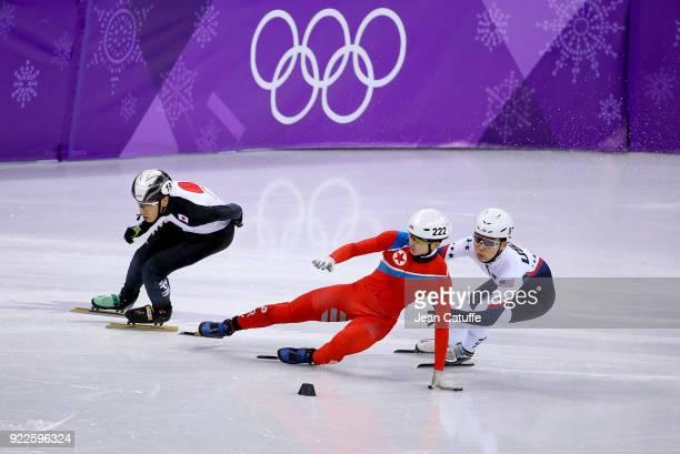 Keita Watanabe of Japan Kwang Bom Jong of North Korea and Thomas Insuk Hong of USA during Short Track Speed Skating Men's 500m series on day eleven...