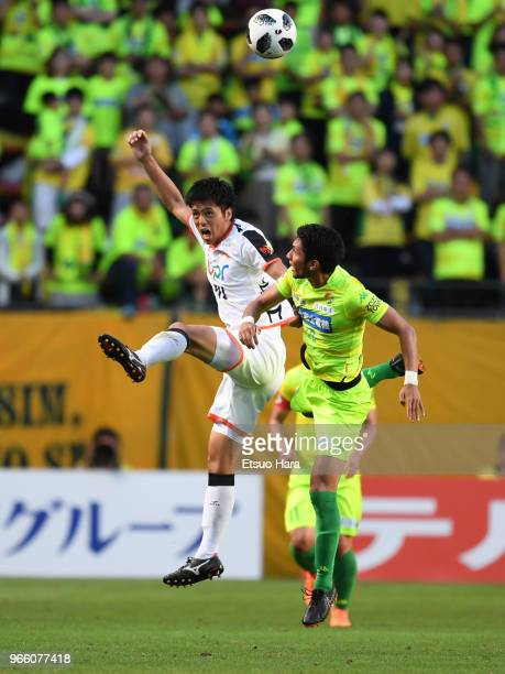 Keita Yamashita of Renofa Yamaguchi and Andrew kumagai of JEF United Chiba compete for the ball during the JLeague J2 match between JEF United Chiba...