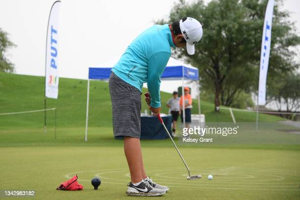 Keita Yobika of the boys 12-13 category attmepts a putt during the 2021 Drive, Chip and Putt Regional Qualifier at TPC Scottsdale on September 26,...