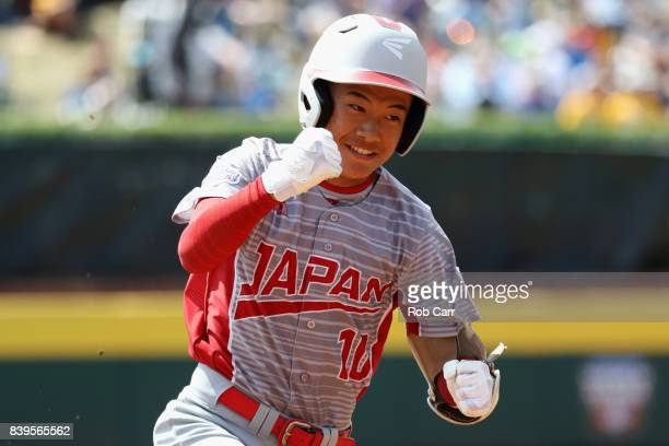Keitaro Miyahara of Japan celebrates after hitting a solo home run against Mexico during the International Championship game of the Little League...
