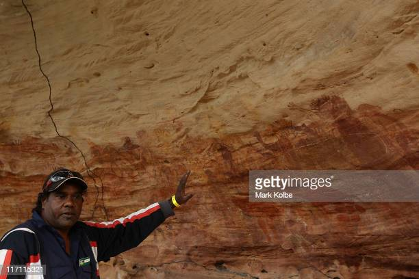 Keith a local guide shows visitors around the Giant Horse Aboriginal rock art galleries in the Quinkan Country on June 19 2011 in Laura Australia The...