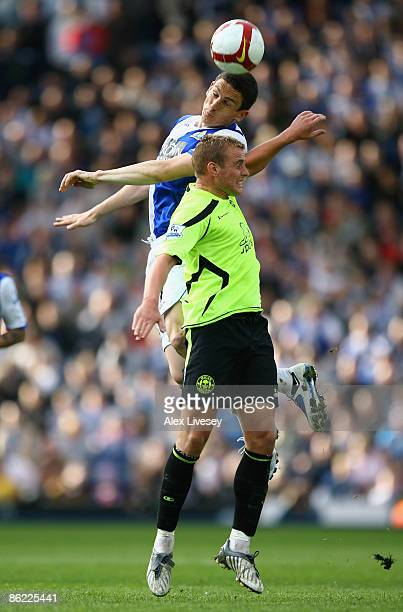 Keith Andrews of Blackburn Rovers beats Lee Cattermole of Wigan Athletic to the ball during the Barclays Premier League match between Blackburn...