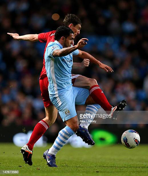 Keith Andrews of West Bromwich Albion tangles with Carlos Tevez of Manchester City during the Barclays Premier League match between Manchester City...