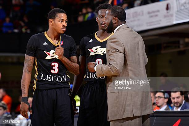 Keith Appling and Myck Kabongo discuss with Anthony Goldwire assistant coach of the Erie BayHawks during the game against the Westchester Knicks at...