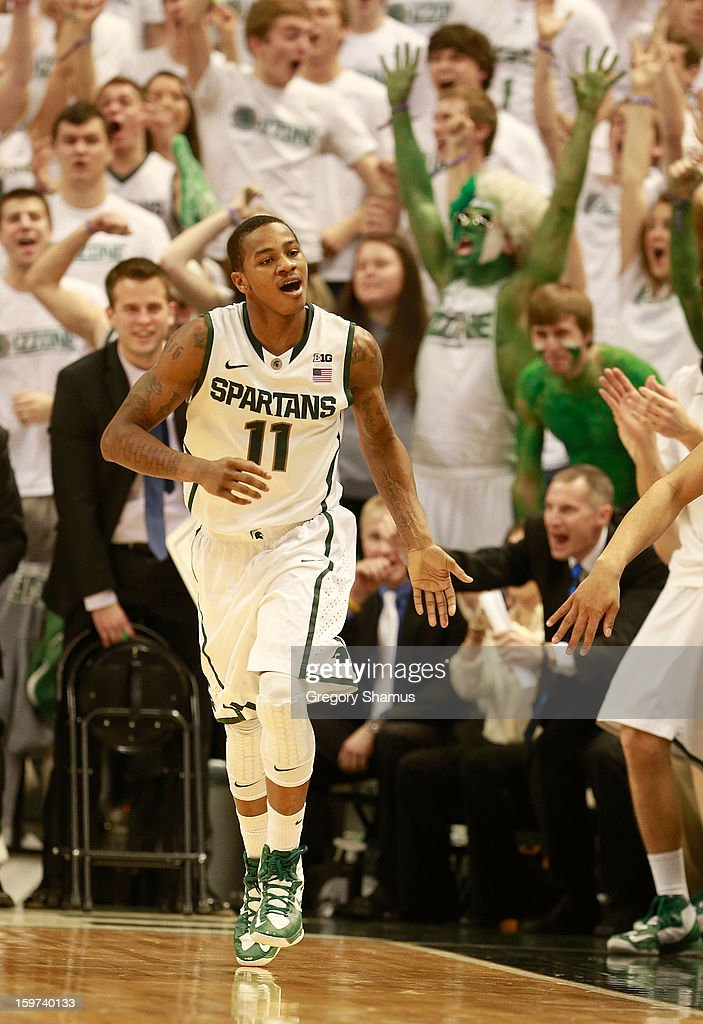 Keith Appling #11 of the Michigan State Spartans reacts after hitting a second-half shot against the Ohio State Buckeyes at the Breslin Center on January 19, 2013 in East Lansing, Michigan. Michigan State won the game 59-56.