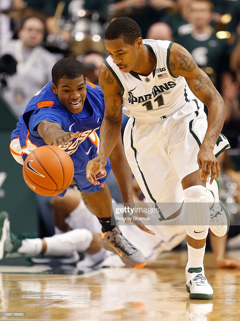 Keith Appling #11 of the Michigan State Spartans steals the ball from Derrick Marks #2 of the Boise State Broncos at the Breslin Center on November 20, 2012 in East Lansing, Michigan. Michigan State won the game 74-70.