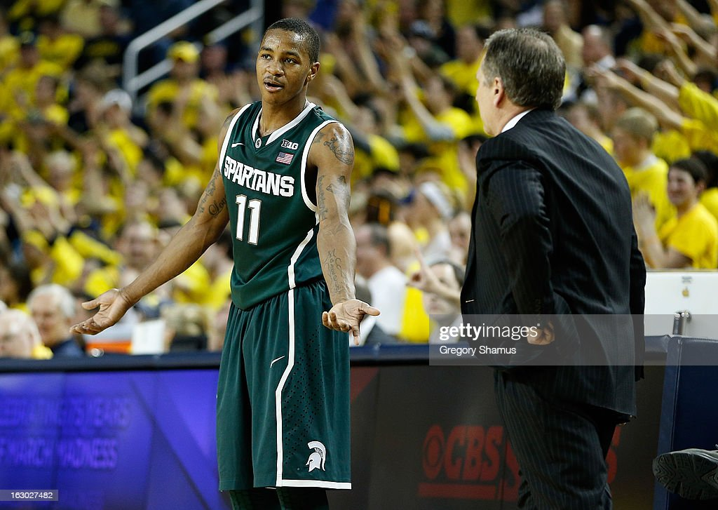 Keith Appling #11 of the Michigan State Spartans talks with head coach Tom Izzo during the second half while playing the Michigan Wolverines at Crisler Center on March 3, 2013 in Ann Arbor, Michigan. Michigan won the game 58-57.