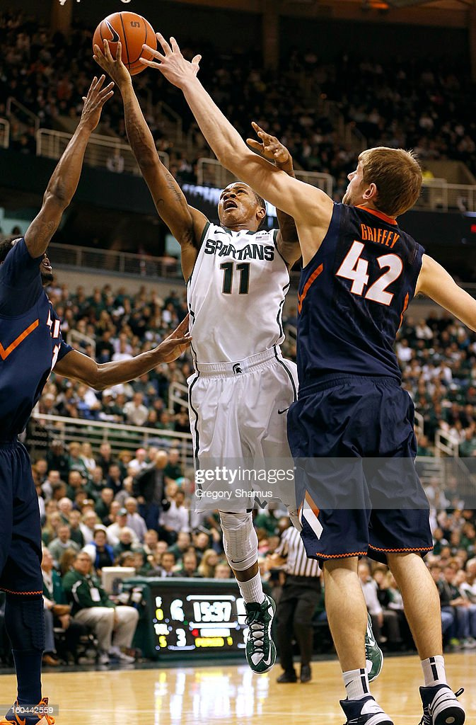 Keith Appling #11 of the Michigan State Spartans tries to get a shot off through Tyler Griffey #42 of the Illinois Fighting Illini at the Jack T. Breslin Student Events Center on January 31, 2013 in East Lansing, Michigan.