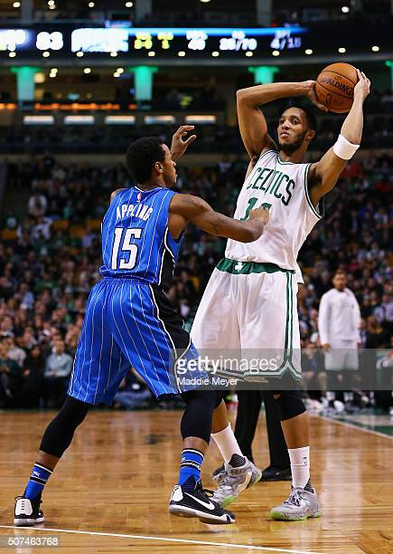 Keith Appling of the Orlando Magic defends Evan Turner of the Boston Celtics during the fourth quarter at TD Garden on January 29 2016 in Boston...
