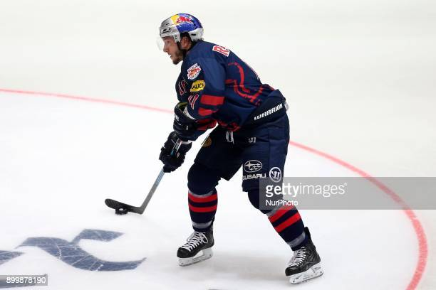 Keith Aucoin of Red Bull Munich during 37th Gameday of German Ice Hockey League match between Red Bull Munich and Thomas Sabo Ice Tigers at...