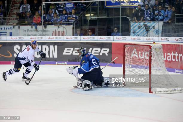Keith Aucoin of Red Bull Munich scores during the 40th game day of the German Ice Hockey League between ERC Ingolstadt and EHC Red Bull Munich in the...