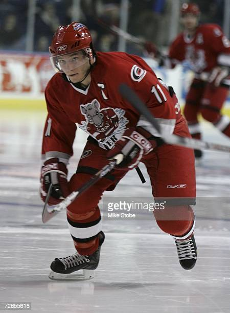 Keith Aucoin of the Albany River Rats skates against the Bridgeport Sound Tigers at the Arena at Harbor Yard on November 26, 2006 in Bridgeport,...
