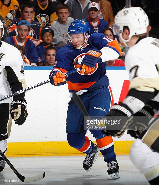 Keith Aucoin of the New York Islanders skates against the Pittsburgh Penguins in Game Six of the Eastern Conference Quarterfinals during the 2013 NHL...