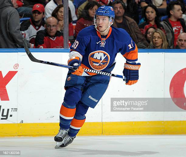 Keith Aucoin of the New York Islanders skates during the game against the New Jersey Devils on February 16 2013 at Nassau Veterans Memorial Coliseum...