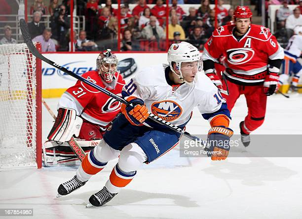 Keith Aucoin of the New York Islanders skates in the offensive zone during their NHL game against the Carolina Hurricanes at PNC Arena on April 23...