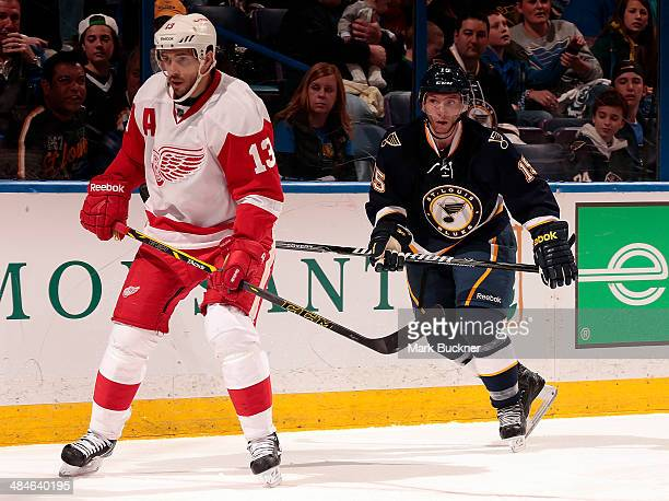 Keith Aucoin of the St Louis Blues skates against Pavel Datsyuk of the Detroit Red Wings during an NHL game on April 13 2014 at Scottrade Center in...