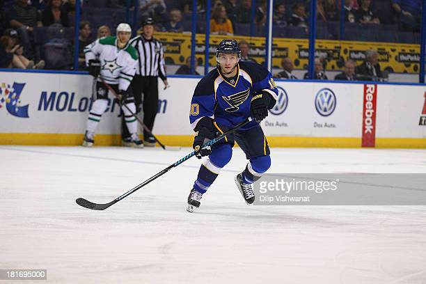 Keith Aucoin of the St Louis Blues skates against the Dallas Stars during a preseason at the Scottrade Center on September 21 2013 in St Louis...