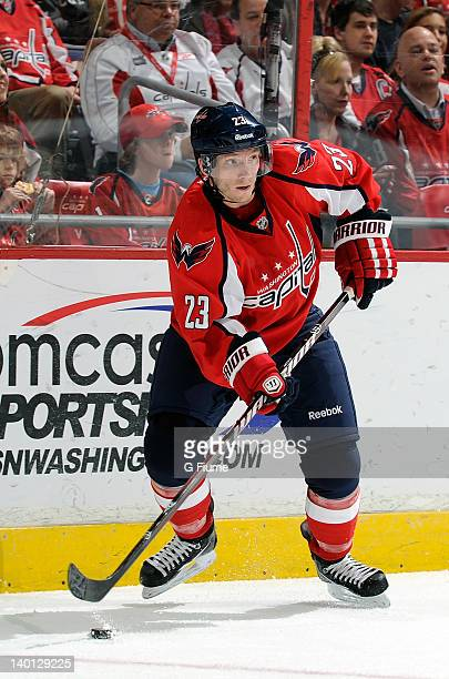 Keith Aucoin of the Washington Capitals handles the puck against the Florida Panthers at the Verizon Center on February 7 2012 in Washington DC