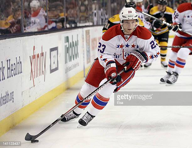 Keith Aucoin of the Washington Capitals takes the puck in the first period against the Boston Bruins on March 10 2012 at TD Garden in Boston...