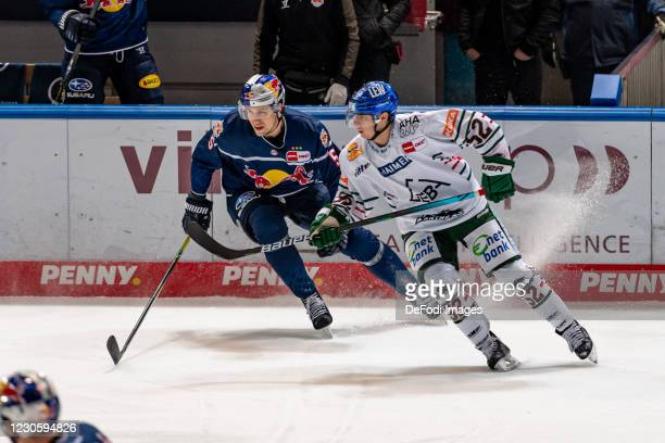 Keith Aulie of EHC Red Bull Muenchen and Dennis Miller of Augsburger Panther battle for the puck during the DEL match between EHC Red Bull Muenchen...