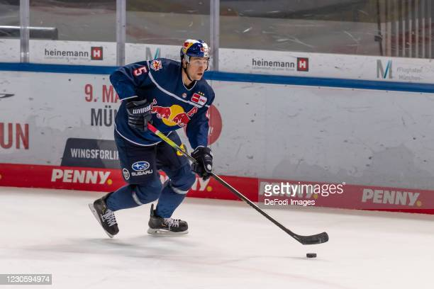 Keith Aulie of EHC Red Bull Muenchen controls the puck during the DEL match between EHC Red Bull Muenchen and Augsburger Panther on January 12, 2021...