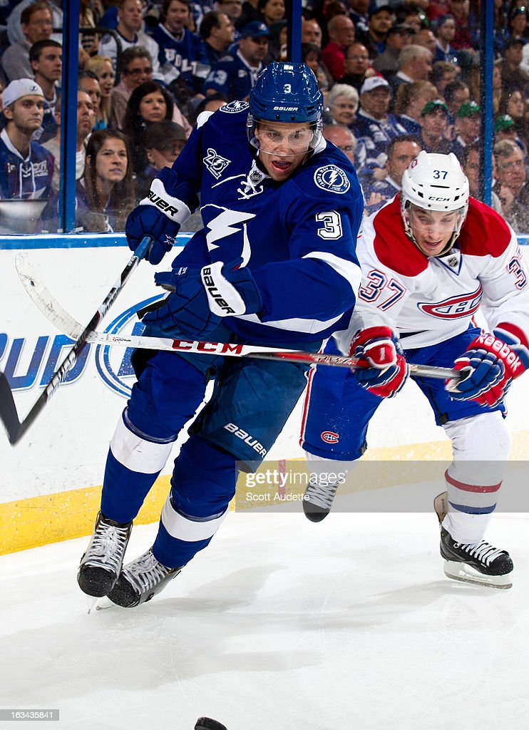 Keith Aulie #3 of the Tampa Bay Lightning controls the puck in front of Gabriel Dumont #37 of the Montreal Canadiens during the second period of the game at the Tampa Bay Times Forum on March 9, 2013 in Tampa, Florida.