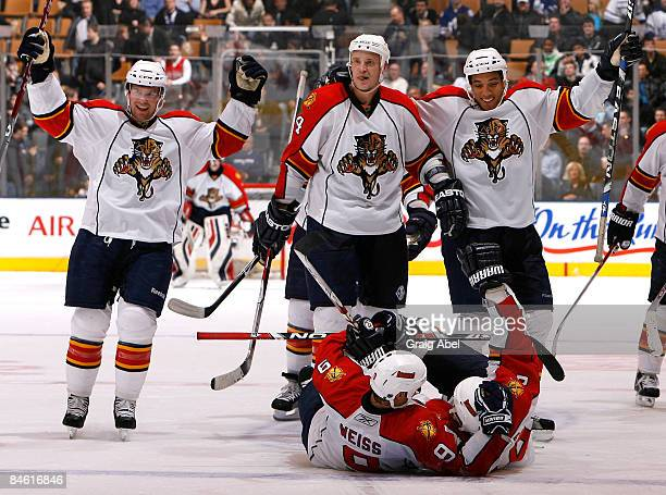 Keith Ballard, Jay Bouwmeester, Anthony Stewart, Stephen Weiss, Bryan McCabe celebrate an overtime goal against the Toronto Maple Leafs of the...
