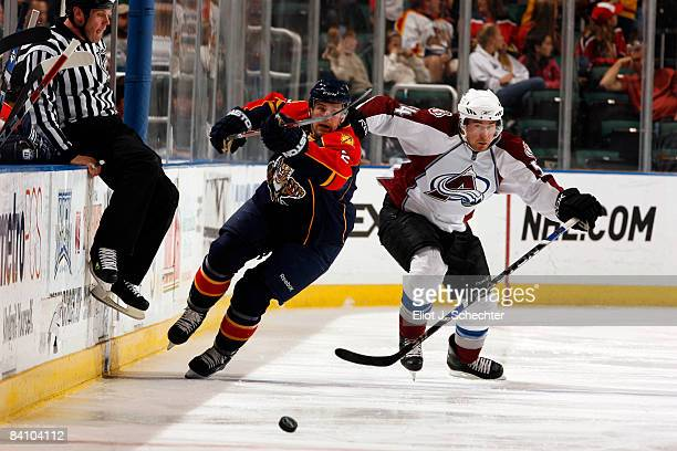 Keith Ballard of the Florida Panthers skates toward the puck against David Jones of the Colorado Avalanche at the Bank Atlantic Center on December 21...