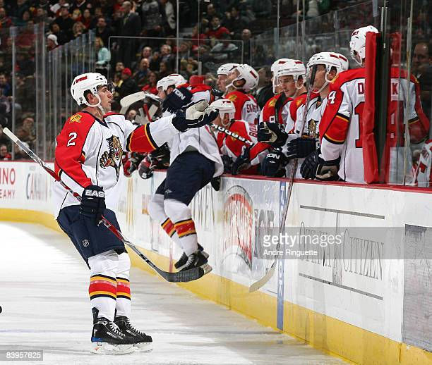 Keith Ballard of the Florida Panthers tosses the puck that teammate Michal Repik scored his first career NHL goal to a trainer in a game against the...