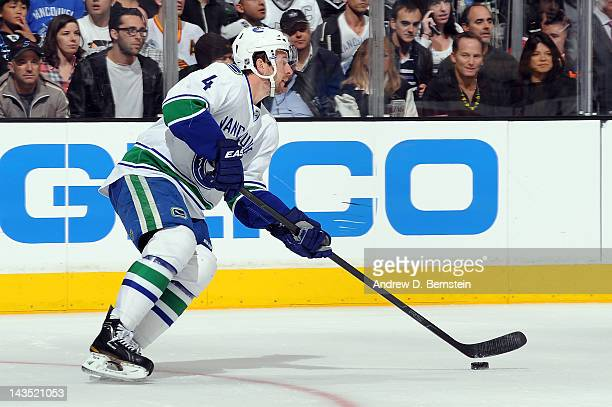 Keith Ballard of the Vancouver Canucks skates with the puck against the Los Angeles Kings in Game Four of the Western Conference Quarterfinals during...