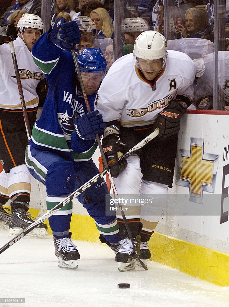 Keith Ballard #4 of the Vancouver Canucks tries to tie up Teemu Selanne #8 of the Anaheim Ducks behind the net during the third period in NHL action on January 20, 2013 at Rogers Arena in Vancouver, British Columbia, Canada.