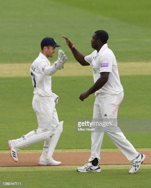Keith Barker of Hampshire celebrates with Lewis McManus after dismissing Luke Wells of Sussex during a friendly match between Sussex and Hampshire at...