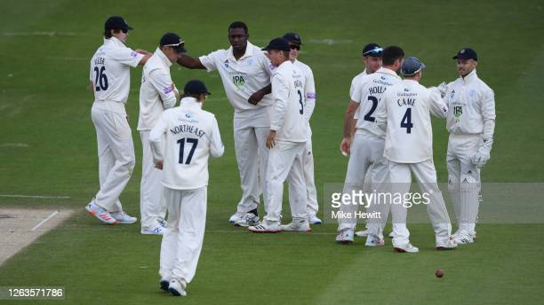 Keith Barker of Hampshire is congratulated by team mates after dismissing Delray Rawlions of Sussex during Day 3 of the Bob Willis Trophy match...