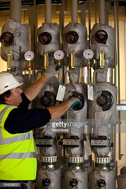 Keith Barnes a technical operator checks controls in the primary digestion control room at Severn Trent's crop fed power plant in Stoke Bardolph near...
