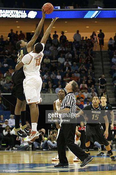 Keith Benson of the Oakland Golden Grizzlies and Tristan Thompson of the Texas Longhorns jump for the ball during the tip off of their game in the...